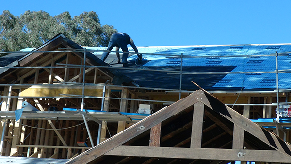roof shingles being installed on new home
